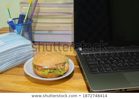 Hamburger with lettuce and tomato on white plate. junk food concept Stock photo © galitskaya