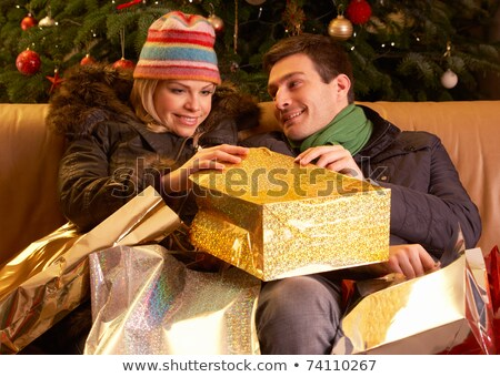 Woman and Man Returning from Christmas Shopping Stock photo © robuart