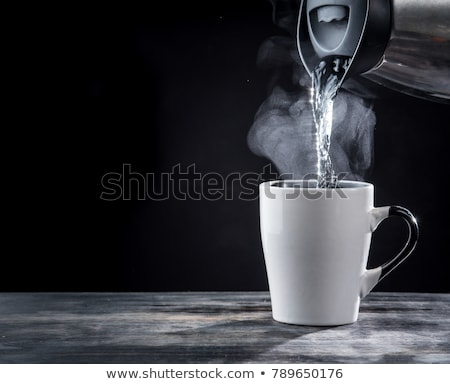 Hot water pouring from kettle in drink Stock photo © dariazu
