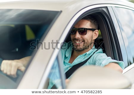 young man in sunglasses driving car Stock photo © dolgachov