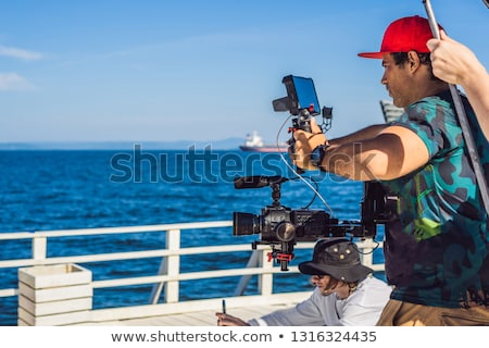 Professional steadicam operator uses a 3-axis camera stabilizer system on a commercial production se Stock photo © galitskaya