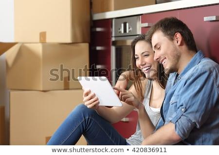 Woman and man deciding on buying a new kitchen Stock photo © Kzenon
