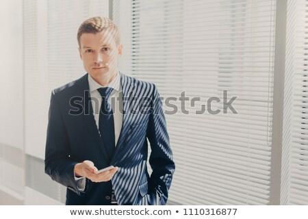 őszinte lövés jómódú üzletember értesítés mobil Stock fotó © vkstudio