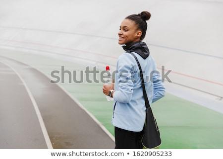 Mosolyog fitt fiatal afrikai sportoló hordoz Stock fotó © deandrobot
