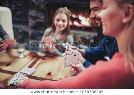 Genç aile iskambil kartları ev adam tablo Stok fotoğraf © Elnur