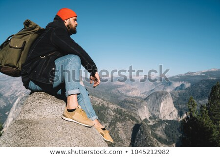male hiker looking at view from yosemite peak stock photo © backyardproductions