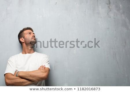 Pensive young man looks upward Stock photo © Paha_L