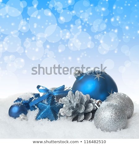 blue and silver baubles in snow stock photo © milsiart
