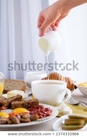coffee cup and pour the milk toast stock photo © stoonn