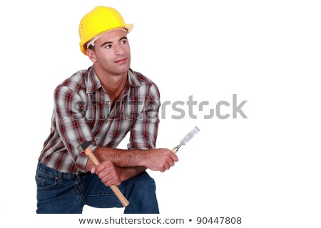 a dreamy tradesman holding a hammer and chisel stock photo © photography33