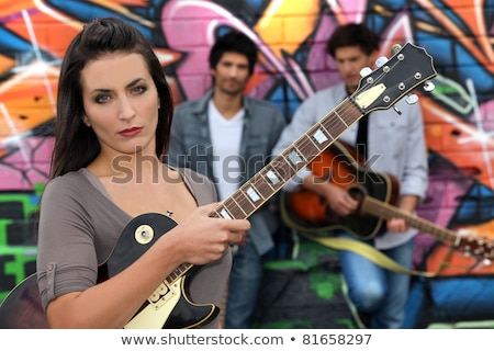 Female guitarist standing in front of graffiti Stock photo © photography33
