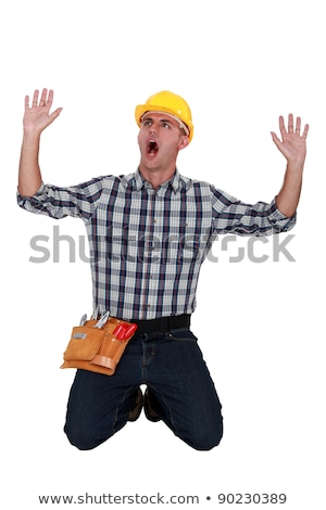 craftsman on his knees raising hands and shouting Stock photo © photography33