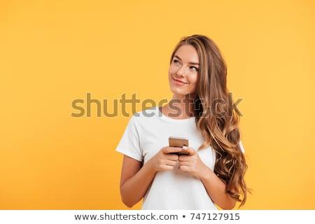 портрет · красивая · девушка · мобильного · телефона · еды - Сток-фото © konradbak