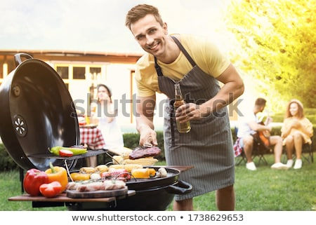 Man with tongs Stock photo © photography33