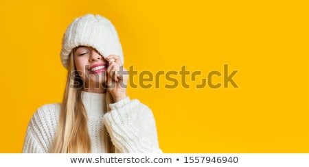 pretty eyes of a woman in wool sweater stock photo © imarin