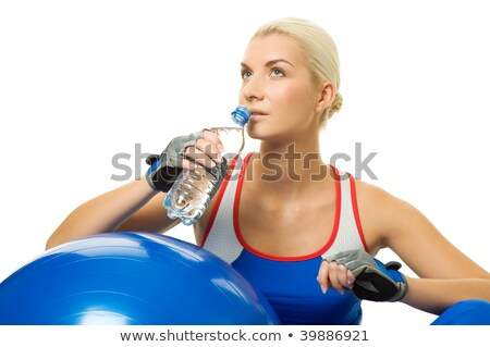 Attractive girl trains in aqua aerobics Stock photo © Aikon