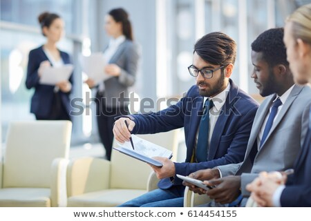 Business professionals discussing a report Stock photo © photography33