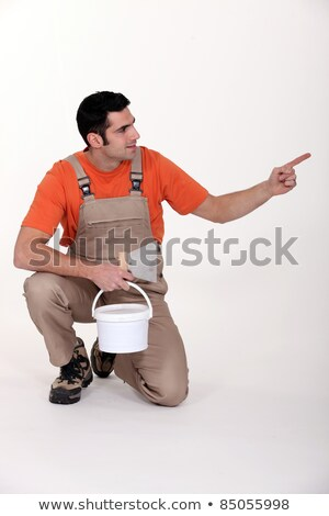 Painter facing and pointing sideways Stock photo © photography33