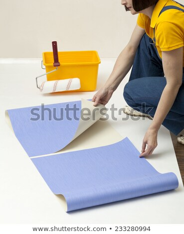 Woman unrolling wallpaper Stock photo © photography33