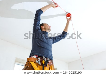 Electrician with a smoke alarm Stock photo © photography33