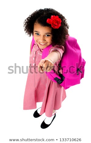 Aerial view of cute girl pointing upwards Stock photo © stockyimages
