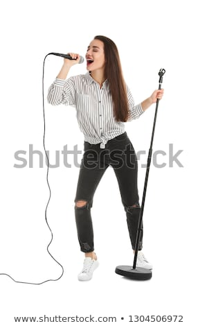 young woman singing in microphone stock photo © andreypopov