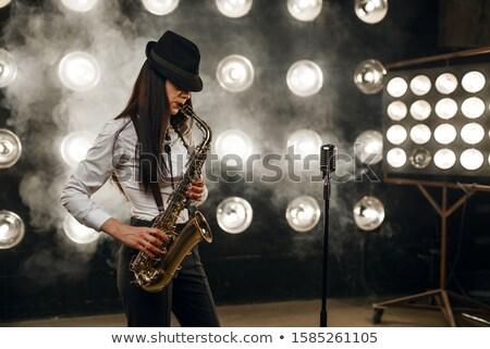 Mujer atractiva saxófono bastante mujer rubia jugando entretenimiento Foto stock © Aikon