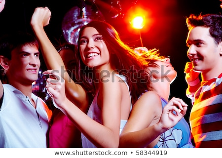 Stok fotoğraf: Attractive Brunette Woman In The Night Club