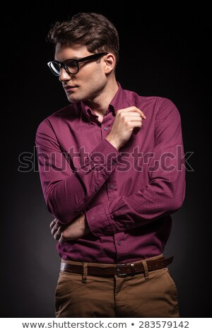 handsome young man looking down while thinking stock photo © feedough