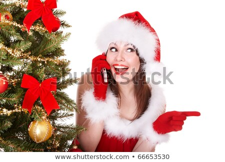 beautiful happy woman in santa claus dress calling phone stock photo © hasloo