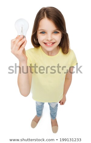 smiling little girl holding light bulb stock photo © dolgachov