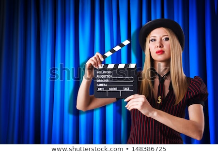 Woman gangster with movie board on white Stock photo © Elnur