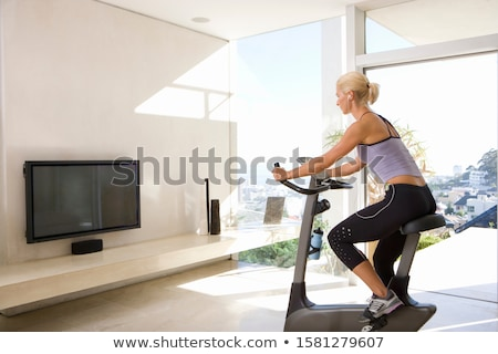 three fit people working out on exercise bikes stock photo © wavebreak_media
