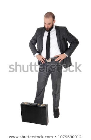 handsome business man looking down thinking stock photo © feedough