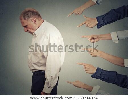 Homem de negócios culpado olhando para baixo isolado homem trabalhador Foto stock © fuzzbones0