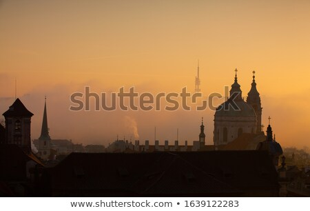 prague saint nicholas church on misty morning stock photo © stevanovicigor