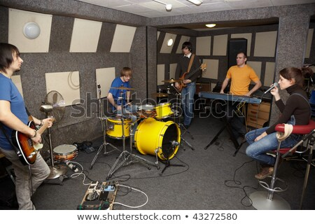 A thoughtful rock band. sad vocalist girl, two musicians with electro guitars and one drummer workin Stock photo © Paha_L