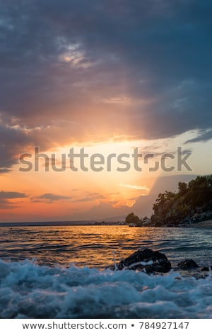 Mer coucher du soleil vagues belle paysage tropicales Photo stock © Mikko