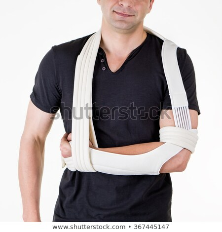 Stock photo: Man with Arm Supported in Sling in White Studio