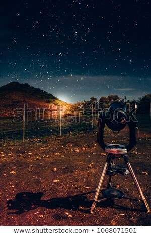 Man looks at the Northern Lights with the telescope Stock photo © adrenalina