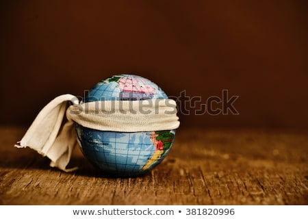 terrestrial globe with a piece of cloth tied around it Stock photo © nito