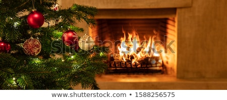 Сток-фото: Christmas Fireplace With Baubles And Blazing Fire
