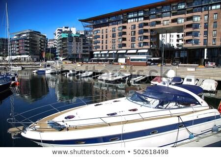 Yacht and modern district on street Stranden, Aker Brygge in Osl Stock photo © vladacanon