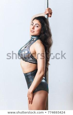Fiatal szőke nő lány pózol pólus rúdtánc Stock fotó © chesterf