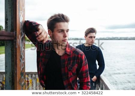 Kettő srácok áll elhagyatott épület tó Stock fotó © tekso