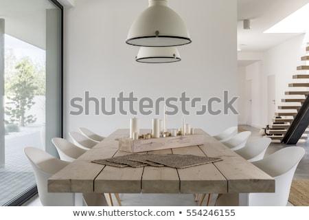 Table à manger maison table bougie intérieur étage Photo stock © konradbak