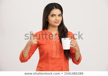 Gyönyörű lány iszik tea kávé kávéscsésze forró Stock fotó © julenochek