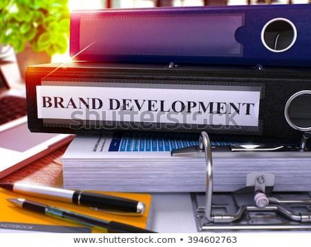 Czarny biuro folderze napis marka rozwoju Zdjęcia stock © tashatuvango