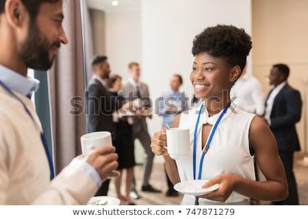 Empresária xícara de café café trabalhando secretária sessão Foto stock © IS2