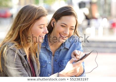Stockfoto: Tienermeisjes · muziekspeler · meisje · kind · technologie